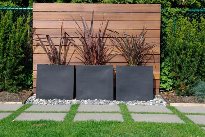 modern landscape by Aloe Designs with horizontal fence and dark metal (?) planters
