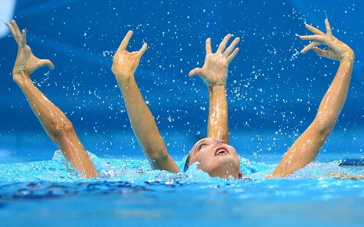 Britain's Jenna Randall and Britain's Olivia Federici compete in the duets free routine preliminary round during the synchronised swimming competition