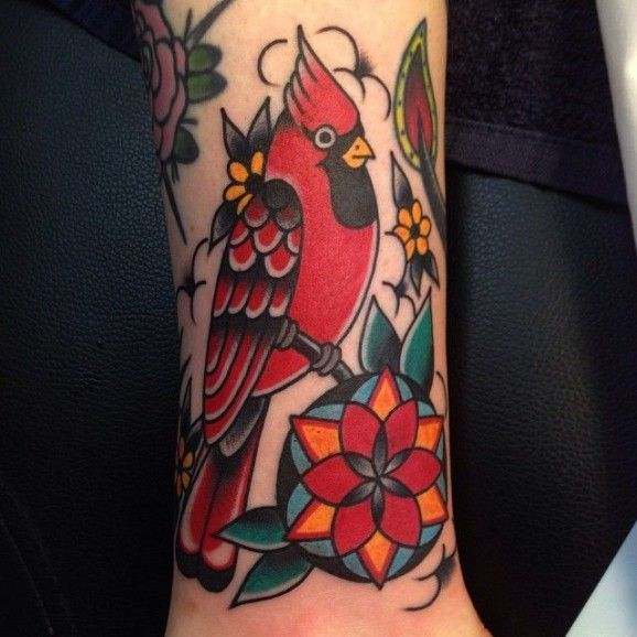Simple, bold outlines & bright colors =keys to a good traditional tattoo. Cardinal tattoo by Ben Rorke.