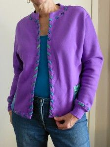 Upcycled Sweatshirt to Purple Cardigan Thanks to a particularly nasty encounter with a flu bug I've been under the weather and very limited in creative energy. In fact, for a number of days, I existed on fluids and slept. Now hubby is dealing with it. However, a bit of hand work did manage to