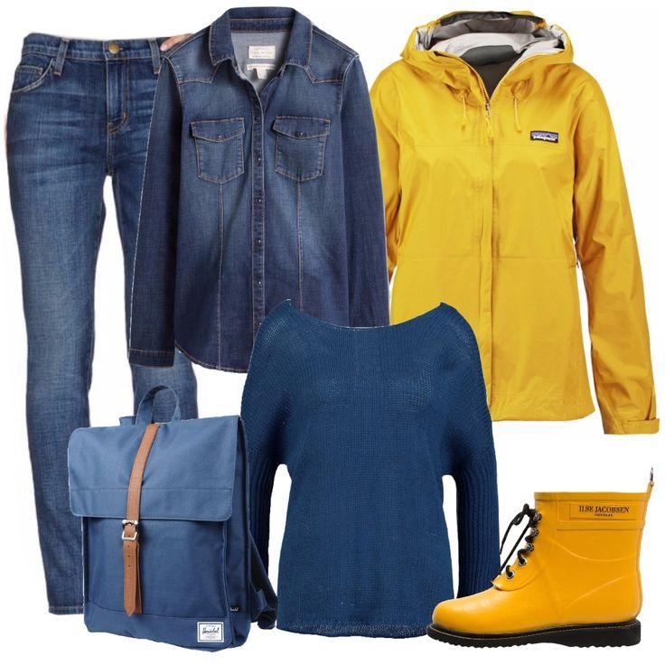 Un look pratico per muoversi in comodità sotto la pioggia: una base in denim, cn jeans skinny e camicia di jeans. Sopra un maglione blu con ampio scollo a barchetta. Ai piedi dei simpatici stivaletti gialli in gomma, e per uscire un impermeabile giallo con cappuccio. All'insegna della praticità, uno zainetto blu, anch'esso impermeabile. Mani sempre libere, ma al riparo dall'acqua.