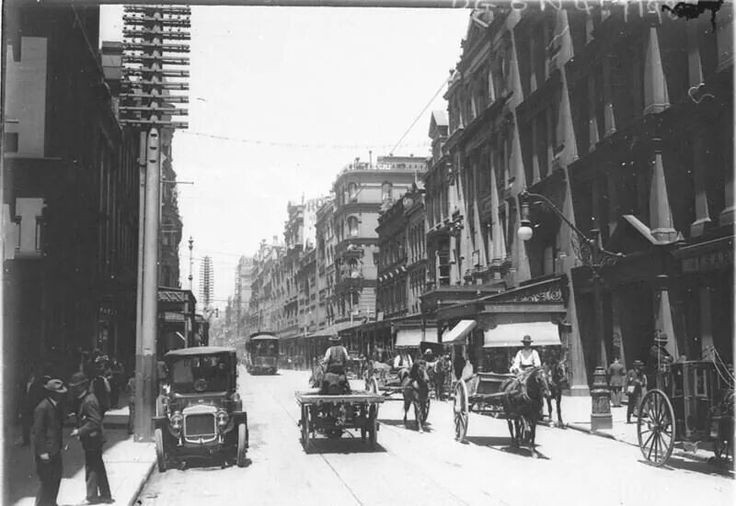 View of Pitt St,looking south from Rowe St with tram crossing King St,Sydney in 1913.A♥W