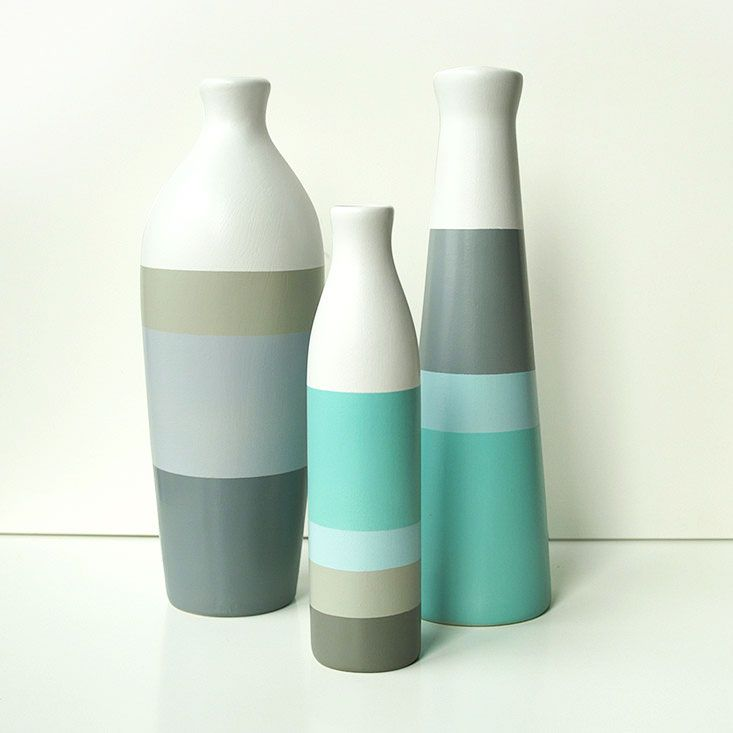 These are cheerful. Shades of Blue Vases - Set of 3 | dotandbo.com  Ceramic hand painted from Poland.