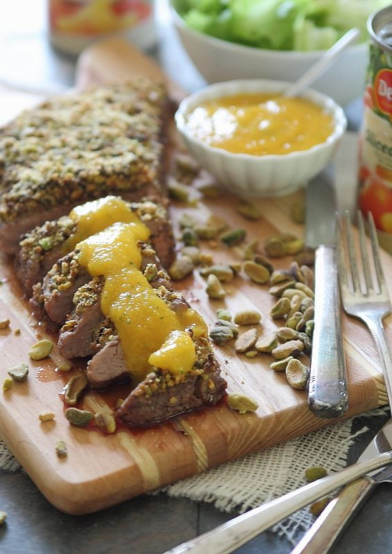 Pistachio crusted flank steak with peach puree | www.runningtothekitchen.com #ad