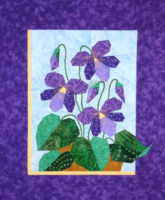 Paper pieced wall hanging. Violets Quilt Pattern DW2-151 by The Designer's Workshop - Eileen Bahring Sullivan.  Check out our wall hanging patterns. https://www.pinterest.com/quiltwomancom/quilted-wall-hangings/  Subscribe to our mailing list for updates on new patterns and sales! https://visitor.constantcontact.com/manage/optin?v=001nInsvTYVCuDEFMt6NnF5AZm5OdNtzij2ua4k-qgFIzX6B22GyGeBWSrTG2Of_W0RDlB-QaVpNqTrhbz9y39jbLrD2dlEPkoHf_P3E6E5nBNVQNAEUs-xVA%3D%3D