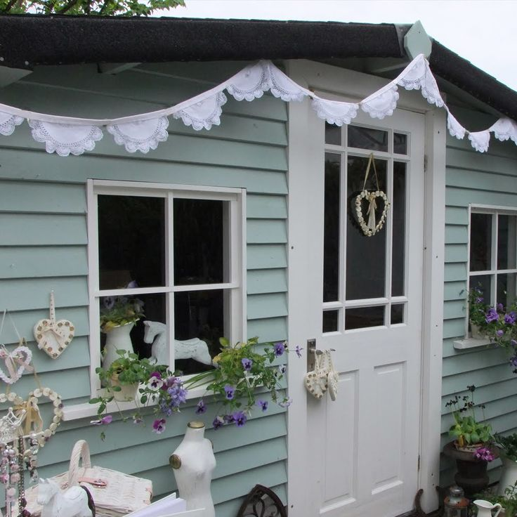 wickes garden colour bluebell with a touch of herb paint for a smokey blue , such pretty bunting too .