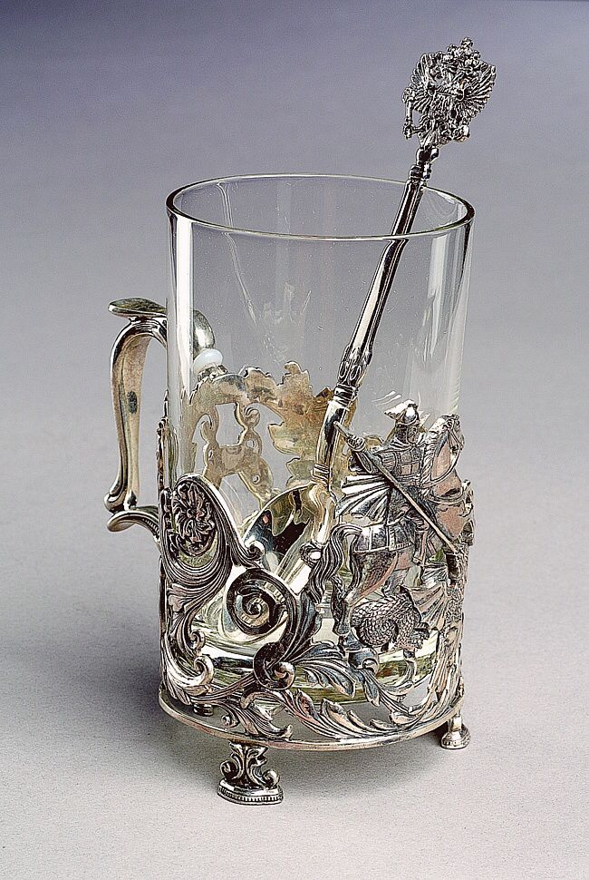 "It's a podstakannik (literally, ""a thing under the glass""), or tea glass holder, that appeared in Russia in the 18th century. These holders were made from silver, or were gold-plated, but common people used cups or holders from metals. The primary purpose of this thing was to hold a very hot glass of tea, which was usually served very hot in Russia. The fashion for these holders came to Russia with Alexander III and survived nearly 100 years, until 60s of the 20th century, when such silver…"