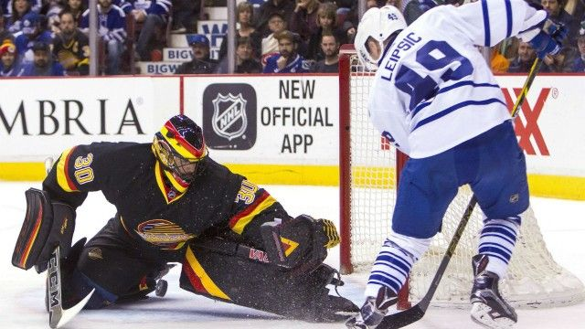 Mark Arcobello scored his first two goals of the season 17 seconds apart and Brendan Leipsic added his first NHL goal in his first game as the Toronto Maple Leafs defeated the Vancouver Canucks 5-2 on Saturday night.