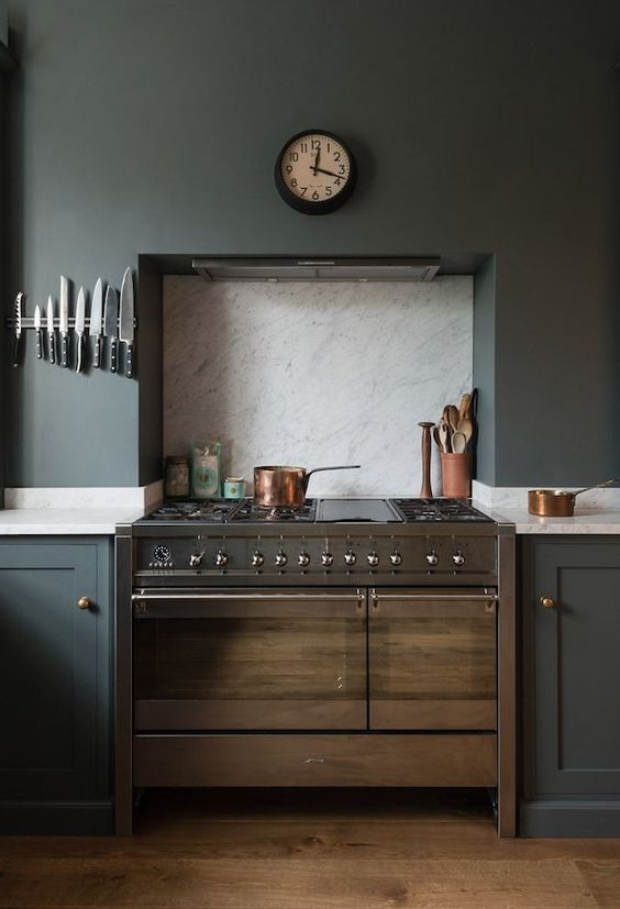 Free up some counter space by skipping the clunky knife block and installing a magnetic bar. | Designer: deVOL Kitchens