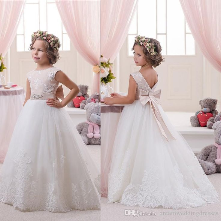 The big girl dresses which match the flowers- beautiful cute flower girls dresses with appliques ball gown tulle back bowknot floor length little girls first communion formal dresses is offered in dreamweddingdresses and on DHgate.com black dresses for girls along with camo flower girl dresses are on sale, too.