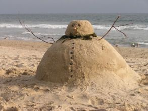 "Build a ""sandman"" - the sand equivalent of a snowman. He should turn a few heads!"