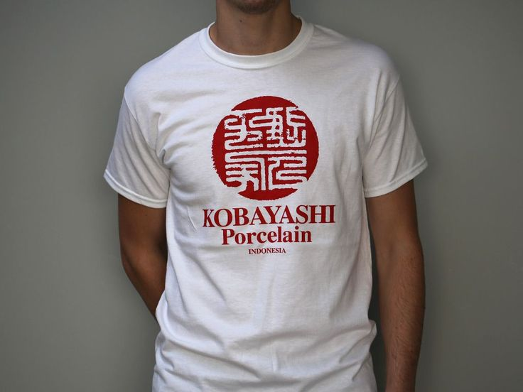 A single colour design, hand screen printed on a regular fit 100% cotton white T-shirt.
