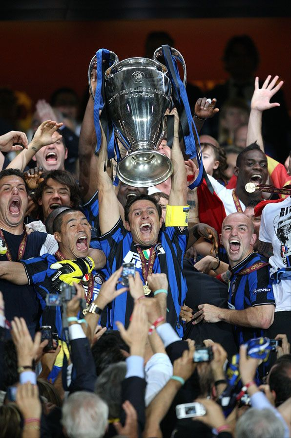 Javier Zanetti, Inter Milan (1995–2014, 615 apps, 12 goals). Zanetti raises the Champions League trophy after Inter's final win over Bayern Munich at the Santiago Bernabéu, May 2010.