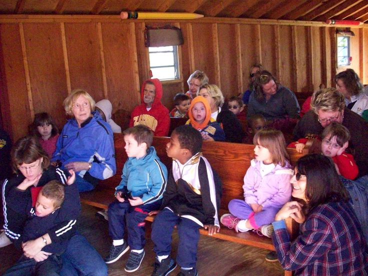 "Classes visit ""Johnny Appleseed"" in his school house and get a short lesson about the history of his story."