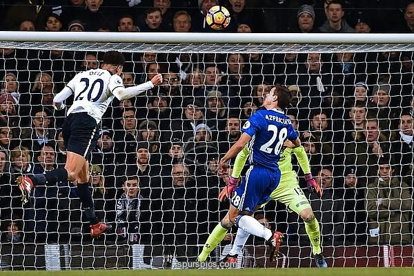Tottenham Hotspur's English midfielder Dele Alli (L) heads the opening goal past Chelsea's Belgian goalkeeper Thibaut Courtois (R) during the English Premier League football match between Tottenham Hotspur and Chelsea at White Hart Lane in London