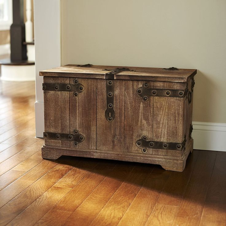 Reduce household clutter by storing clothing, toys, or paperwork in this large wood trunk. Featuring Victorian styling, metal hardware, and ring handles, this storage trunk brings vintage rusticity to
