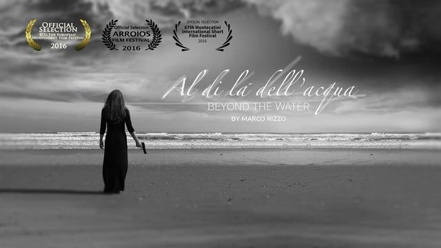 Logline: The terrible mission of a girl, clashes with the coveted hope of a new life, combining madness and dreams on a bloody shore. Synopsis: A girl sitting on the sand, waiting with a gun in her hands looking the sea. Something appears at the horizon: men, women, children try to swim to reach the seashore.   Production: Italian Language: No Subtitles: No Format: 16/9 - Color/b&w Time: Short 8:41min Type: Fiction  Director: Marco Rizzo Screenplay: Marco Rizzo Producer: Giovan...