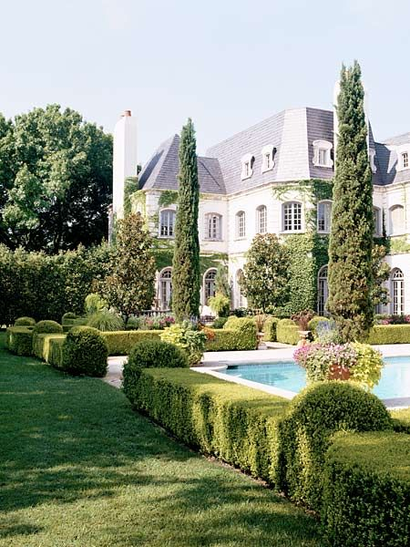This French-style Dallas house is surrounded by beautiful gardens, in keeping with its formal feel