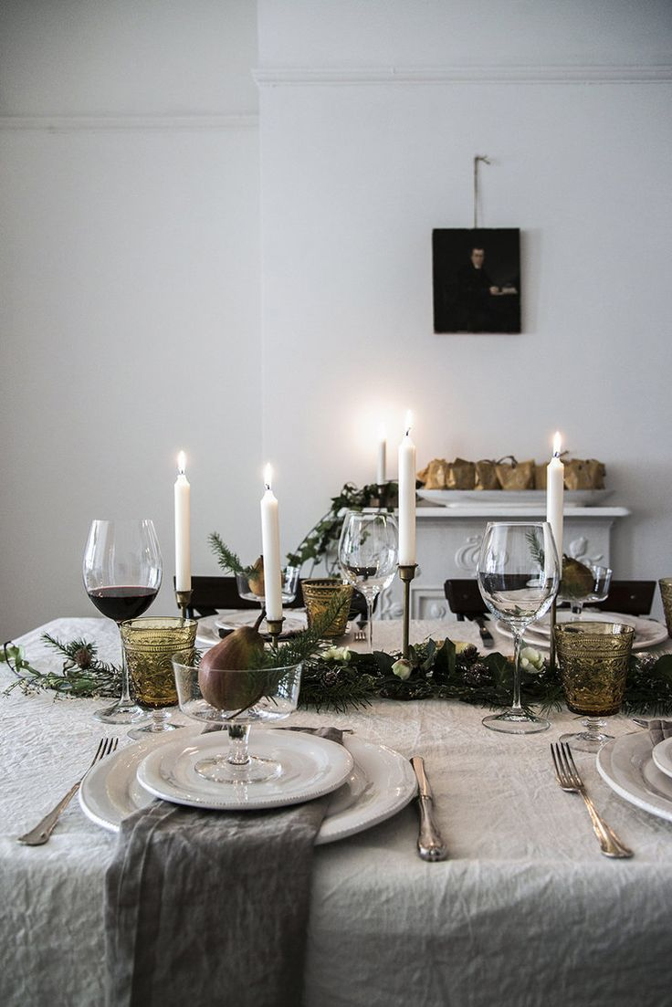 A royal spread with a wreath table runner and candles for an authentic finish.
