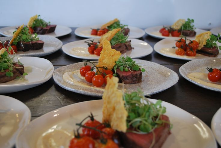 Seared Wakanui Beef Fillet with rocket, roasted vine tomato, pecorino & caesar dressing.