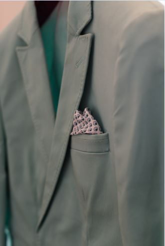 Mint jacket for a different and fun groom outfit.  ~ Image Property of Darren Bester Photography