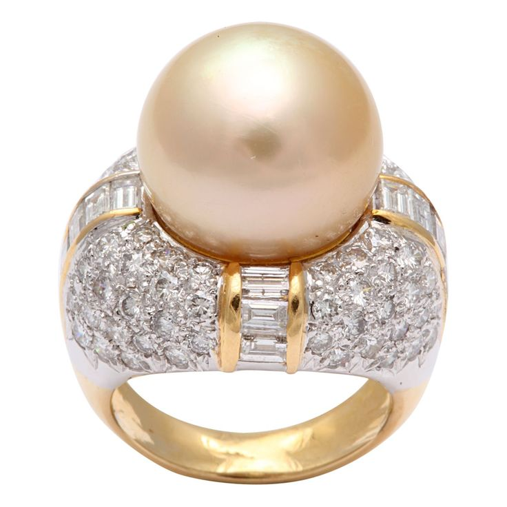 1stdibs | Trio South Sea Pearl & Diamond Ring. 18kt Yellow Gold ring partitioned on an Axis & set alternately with clean White Full cut round Diamonds & Diamond Baguettes. Set with 14 1/2mm Yellow south Sea Pearl. Size 4 1/2
