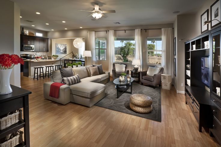 Love this! Open layout, furniture, room flow... I would take this idea with a white kitchen and darker wood floors :)