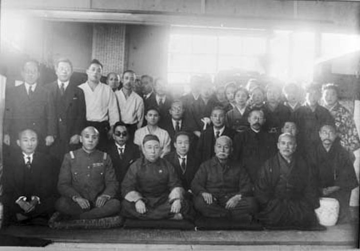 "The Mongolian prince Teh Wang (Demchugdongrub), the leader of the Japanese puppet state Mengjiang, with dignitaries from the Japanese puppet state of Manchukuo (Manchuria) at the Kobukan Dojo in 1938. Admiral Isamu Takeshita and Morihei Ueshiba to the right of the prince. Also present are Gozo Shioda, Aritoshi Murashige and Morihei Ueshiba's wife Hatsu. This is the same year the Morihei Ueshiba published his 1938 manual for for Prince Kaya Tsunenori, available in ""Budo – Moritaka Ueshiba's…"