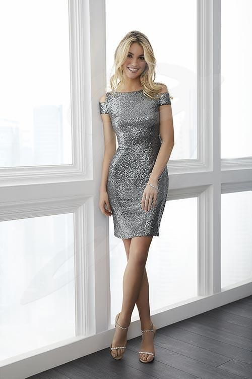 Balletts Bridal - 24820 - Bridesmaids by Jacquelin Bridals Canada - This short sheath dress is made up of sequin and has a stretch lining for added comfort. The sleeve features a fashion forward cold shoulder detail. Pictured in Charcoal.
