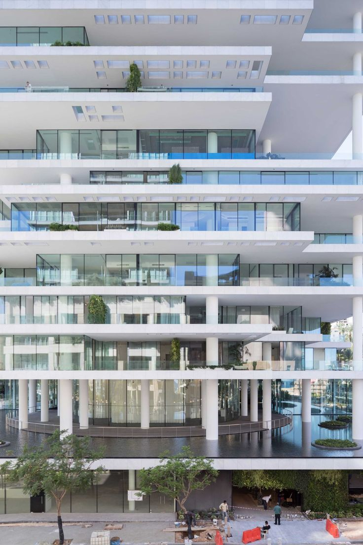 Staggered floor plates and set back glazing create large planted terraces around this tower by swiss architects herzog s