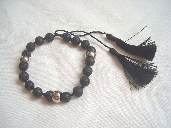 LAVA STONE tassel bracelet hand knotted . by  ExtravaganzaBali  $9.50 USD