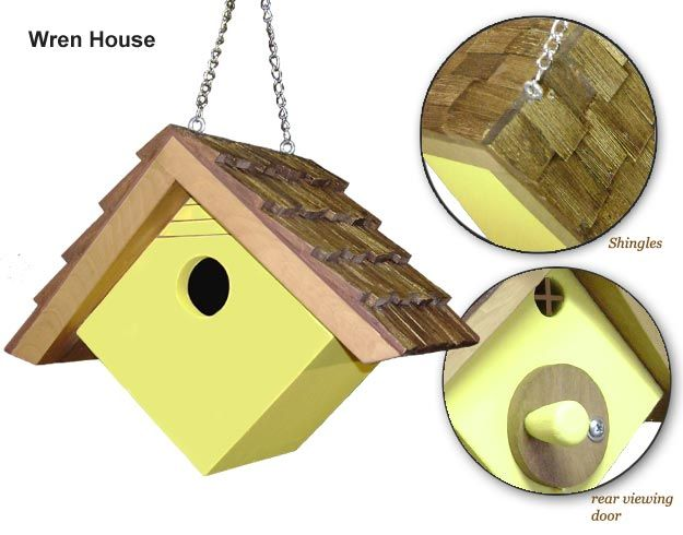 "Small Wrenhouse: featuring a rear viewing door, rear window, spintered roof shingles (offset). Dimensions are 7 1/4""h x 9""w x 7 3/4""d.  Entrance hole is 1 1/8"" diameter. Built from cedar wood and held together with Titebond II Weather proof wood glue and long fastener screws. Two eyebolts mounted on the roof will provide secure hanging."
