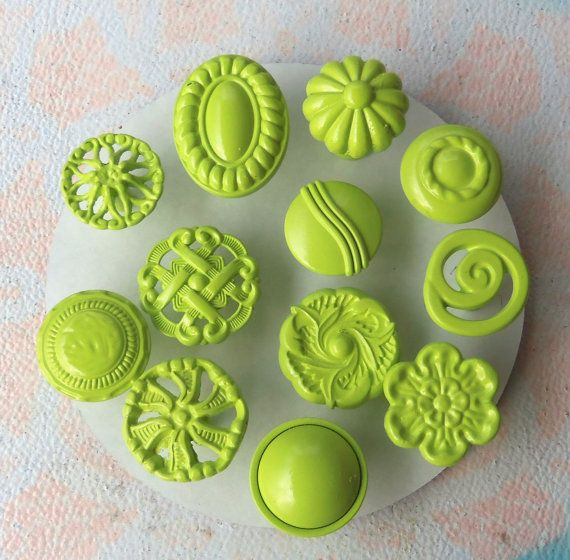 Collect old knobs and spray paint them