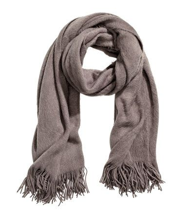 Dark taupe. Soft scarf with fringe at ends. Size 27 1/2 x 70 3/4 in.