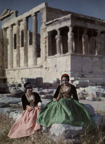 Women wear authentic garb from Crete (left) and Peloponnesus (right).                Acropolis, Athens, Greece.  Photographer: MAYNARD OWEN WILLIAMS/National Geographic Creative