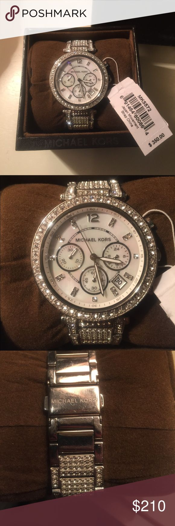 Brand New Michael Kors Silver Watch This brand new Michael Kors Watch has diamonds covering the band. The face includes three other watches for a minute, hour, and to tell military time. It also can tell you he date. It comes with extra lengths, guide, and Michael Kors box. It is new with tags and was originally $350. KORS Michael Kors Accessories Watches