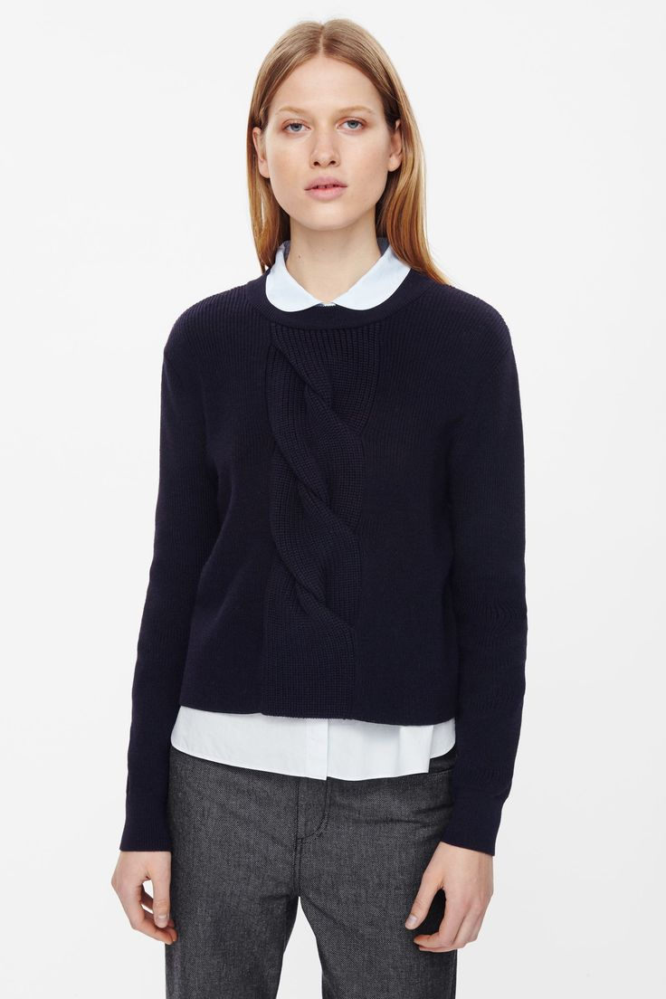 Made from merino wool, this cropped jumper has a cable-knit feature at the front. A boxy fit, it has tightly ribbed finishes and an oxidized back zip.