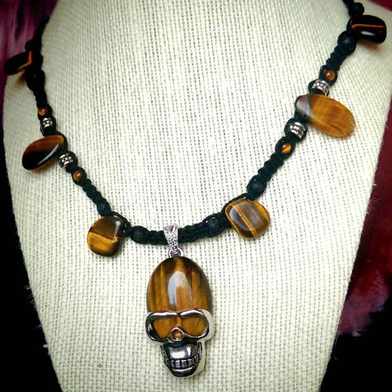 Check out this item in my Etsy shop https://www.etsy.com/ca/listing/270292432/tiger-eye-skull-pendant-black-hemp