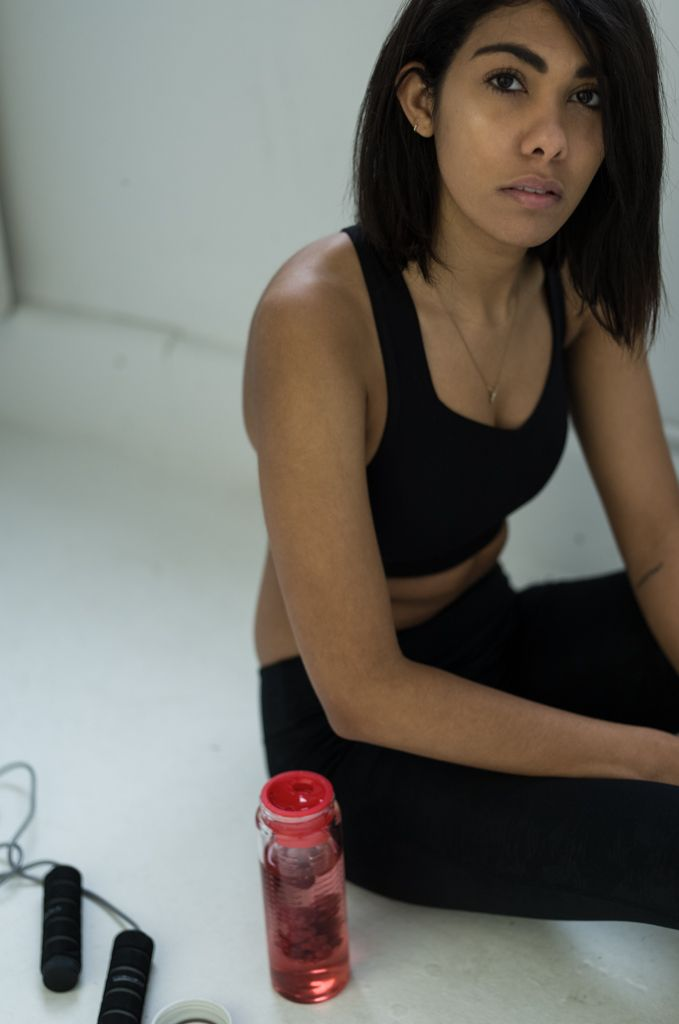 sportswear with tk maxx and a water bottle for fruit with black sportbra and pants