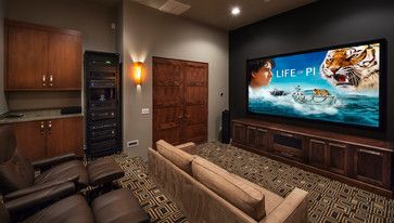 KW: This is a what NOT To do... We do NOT want the components exposed in the media room.  (DM: No blinky lights when you're trying to watch a movie.) Tonto Verde Contemporary 1 contemporary-home-theater