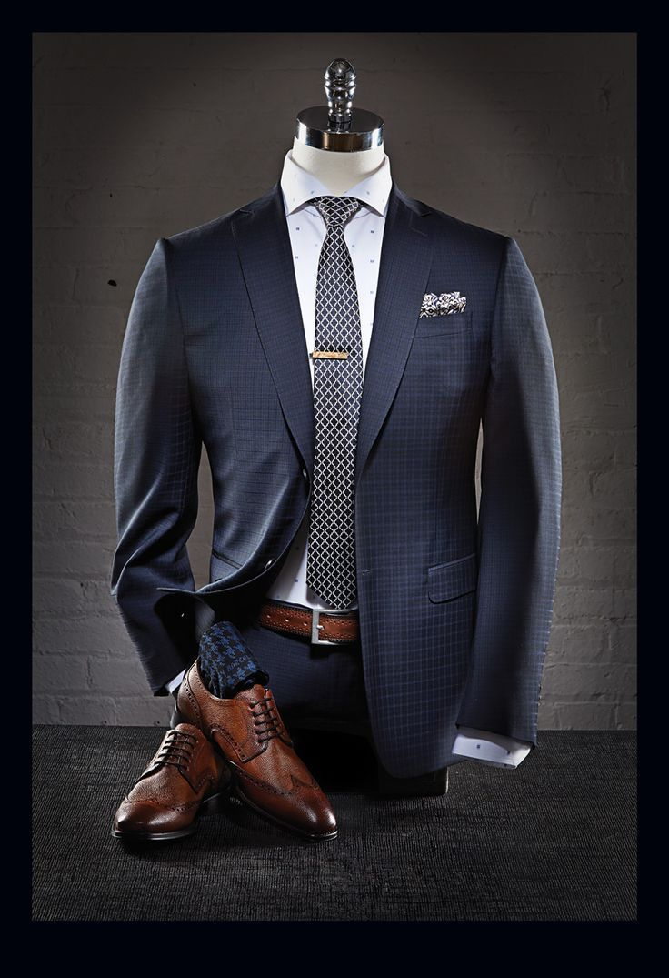 A sharp grey blazer and slacks offset with brown shoes make for either a formal or office meeting attire combination . . .