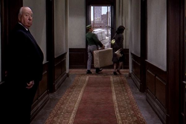 """""""Marnie"""" (1964) - Sly winks to the camera were a Hitch hallmark. Usually they're stylistic; in this case he offers a real one. He appears from a hotel room just as Tippi Hedren wanders past with hair dyed, turns to the camera and gives us a look that says 'did you see that?'"""
