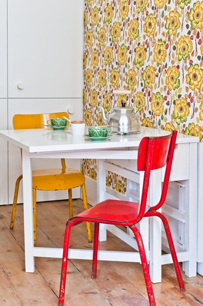Josef Frank wallpaper and colourful chairs in the kitchen of Necessidades apartment, Baixa House    www.baixahouse.com