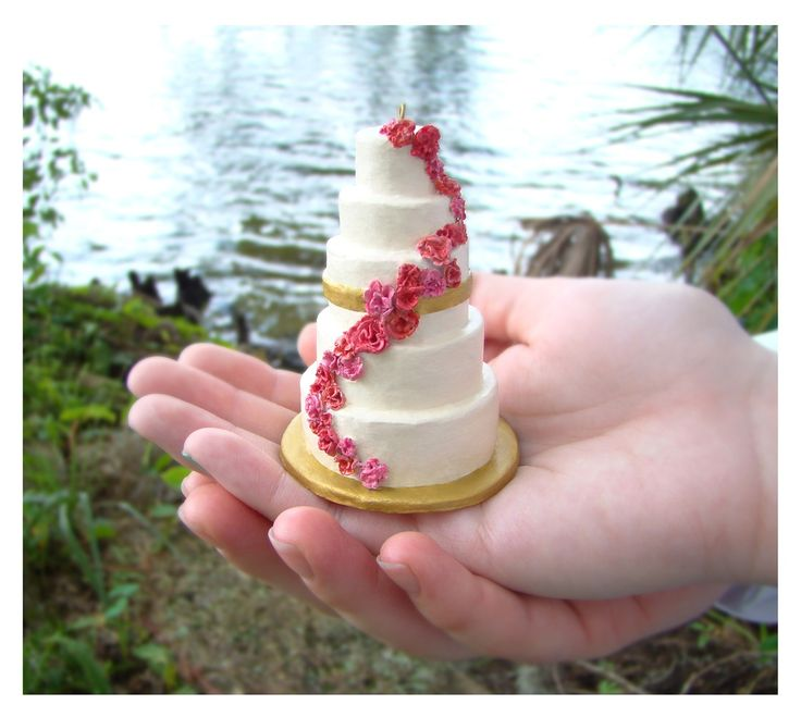 Send pictures of your wedding cake to this company and they will make a christmas tree ornament that looks exactly like your cake.