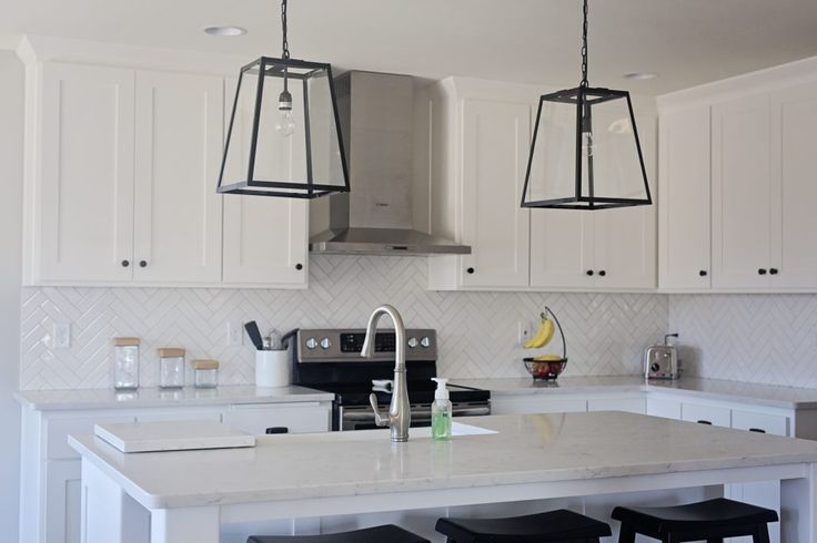 White Tile Kitchen Backsplash In Herringbone Pattern
