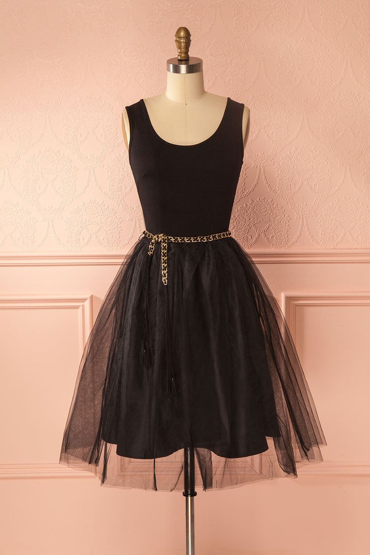 Ayze Black #boutique1861 / Embody the grace and style of a ballerina with this adorable dress! Its soft jersey top and elastic waist will keep you comfortable. The voluminous A-line tulle skirt brings a fun and romantic quality. The faux-leather and gold chain belt will cinch your waist and add a little bling to your look. Pair it with heels and a statement necklace for a special occasion, or sneakers and a denim jacket for a casual look!