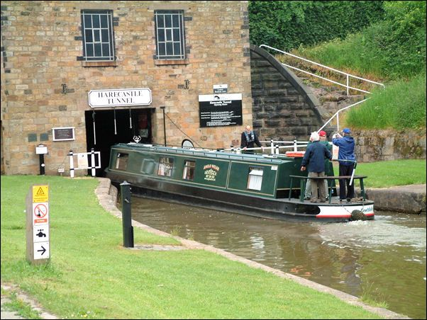 narrow boat entering telford tunnel, mersey canal, harecastle. these super skinny boats have full living quarters in them - kitchens, bathrooms, bedrooms, the works.