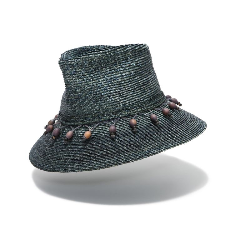 Groper blue hand dyed braid straw hat, hand shaped relaxed feel with an extra lovely wood beaded trim - Mezei #hatmaker #hats #handmadehats #strawhat #strawhats #ladieshats #luxuysunhat #luxurysunhats #luxurytrim #woodenbeads #womenshat #jonathanhoward www.hatmaker.com.au