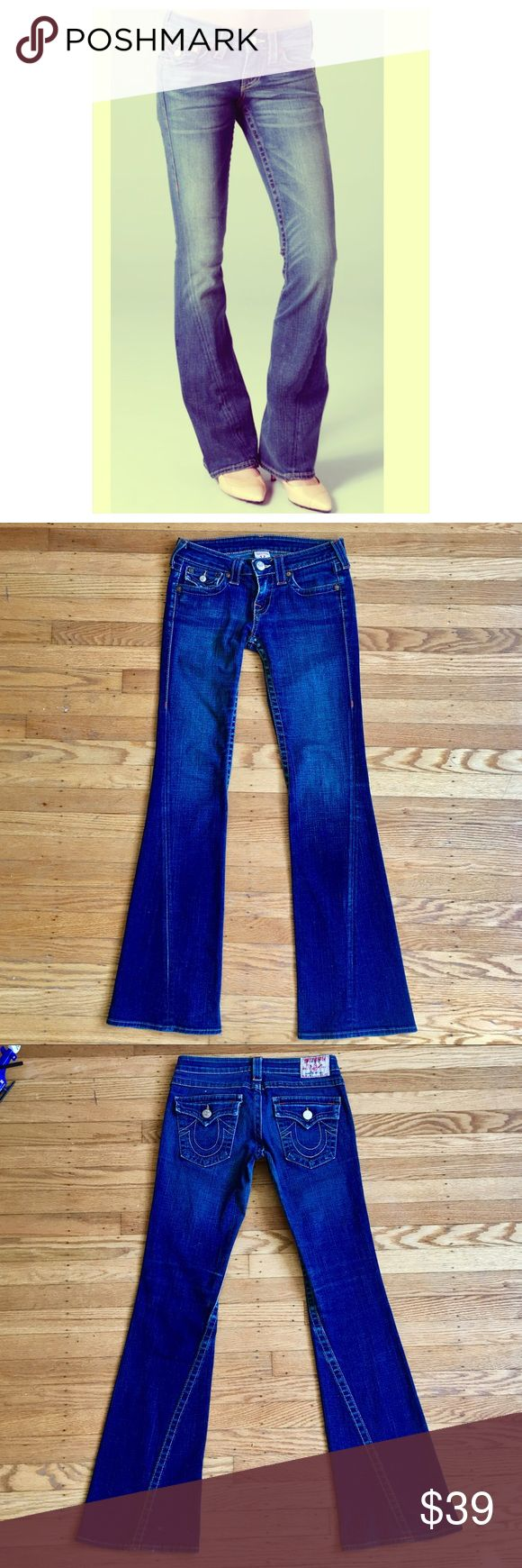 """True Religion Size 27 Joey Flare Preowned. Still FAB! Please see photo of Small Hole on Back of pant leg. It's minor but worth mentioning. Size 27. True Religion Joey Flare in Medium Wash. inseam 33"""" Rise 7"""" waist 14"""" one way leg opening 9.5"""" one way. Thank You!Keep up with this season's trend by adding these Joey flare jeans for women to your closet. With flap button closure pockets and a low rise cut, these flare jeans give retro chic a whole new meaning. 92% cotton, 6% elastomultiester…"""