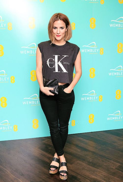 """ Caroline Flack at Hilton London Wembley to celebrate the next stage of the partnership between EE and Wembley Stadium on September 23, 2014 in Wembley, England. """